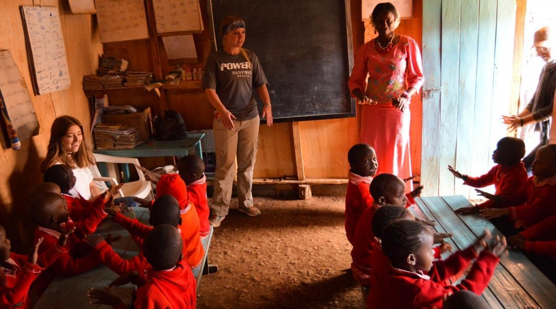 A Teaching volunteer supports a local teacher in a classroom in Kenya.